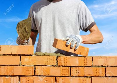 15314663-bricklayer-laying-bricks-to-make-a-wall-stock-photo